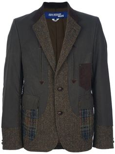 Green wool blend blazer from Junya Watanabe featuring a tweed notched lapel, long sleeves with tweed cuffs and patches on the elbows, arrow dart detailing on the front, a patch chest pocket, two checked front flap pockets and a tweed front button fastening.
