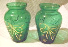 Mouse over image to zoom    Have one to sell? Sell it yourself  **-A PAIR(2) SMALL PRETTY GREEN GLASS VASES WITH GOLD DESIGN AROUND THE SIDES-**