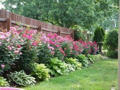 landscaping along privacy fence wood fence residential houston fence company gardens and