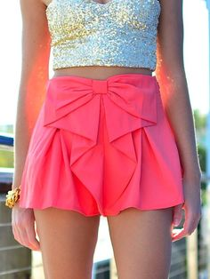 sequin top and pink bow shorts.