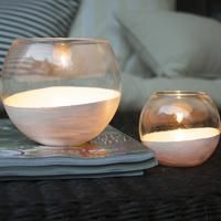 These Painted Glass Luminaries from Dotcoms for Moms are easy to make and will look great on a patio or porch.