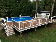 Northeast Specialty Decks - Hudson, NH, United States. Salem, NH. Fiberon Composite Pool Deck with Ipe Horizons decking and hidden fasteners. black aluminum balusters for the railings