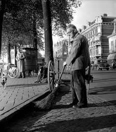 1951. Street sweeper of the municipal sanitation service in Amsterdam cleans the street at the corner of Weesperzijde and Oosterparkstraat. Photo AHF Collectie Amsterdam / Ben van Meerendonk. #amsterdam #1951 #Weesperzijde #Oosterparkstraat.
