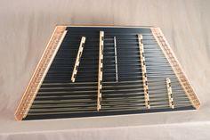 2012 - #1614 - A James Jones 10/19/18/8 Linear Chromatic Hammered Dulcimer with a Mahogany frame, Cedar SB made black, Striped Mahogany pin panels, Maple bridges with Curly Maple trim.  Piano marking