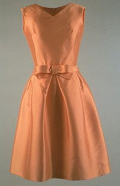 OLEG CASSINI Apricot Silk Ziberline Dress  Worn by Jackie Kennedy during a daytime boat trip in India on March 17th, 1962. It is now on display at the John F. Kennedy Library and Museum
