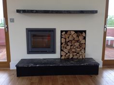 Scan DSA 4-5 installed as part of the Lower Mill project. For the bespoke fireplace we designed a log store and included a mantle piece and hearth made from granite.  #scan #fire #wood #burner #stove #bespoke #fireplace #inset #log #burner #granite #hearth #mantle #kernowfires #wadebridge #redruth #cornwall