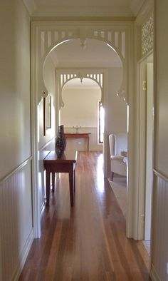A front entry with Federation style fretwork. California Bungalow Interior, Bungalow Interiors, Bungalow Renovation, Cottage Interiors, Front Door Entryway, Entry Foyer, Front Entry, Hallway Decorating, Interior Decorating