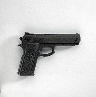Replica Black Rubber Gun - Krav Maga.  Gunfighting is not primarily about guns; it is primarily about fighting.