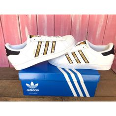 Women's Adidas Original Superstar With Gold Swarovski Crystals ($170) ❤ liked on Polyvore featuring shoes, silver, sneakers & athletic shoes, tie sneakers, women's shoes, black and white shoes, gold shoes, tie shoes, black white shoes and yellow gold shoes