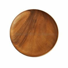 """Acacia Wood Round Plate 11"""" by Naturally Med. $26.99. Carved from a single piece of acacia wood. Diameter: 11"""", thickness 0.7"""". Use as a dinner plate, serving plate or fruit plate. Please note: Photo is an example of the product, not the exact one sent. The natural grain of acacia wood means that each wooden plate is completely unique. Handwash only. This beautiful acacia wood round plate is perfect to use as a dinner plate, a cheese plate or to display fruit etc...."""