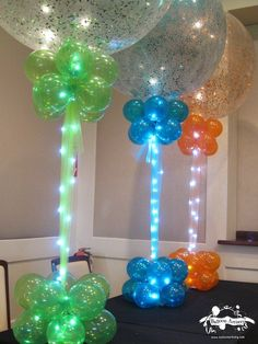Balloon Centerpieces · Party & Event Decor · Balloon Artistry Sparkle Balloons with Rice Lights. Balloon Columns, Balloon Arch, Balloon Ideas, Balloon Designs, Balloon Topiary, Balloon Stands, Balloon Tower, Balloon Lights, String Lights