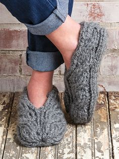 Free Knit Pattern Download -- These Chunky Cable Slippers, designed by KNC Design Team, are featured in episode 8, season 5 of Knit and Crochet Now! TV. Learn more here: https://www.anniescatalog.com/knitandcrochetnow/patterns/detail.html?pattern_id=30&series=2