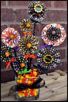 HALLOWEEN CENTERPIECE!!! How fun to make these pin-wheels out of Halloween cardstock. Looks so great, would make a wonderful gift.