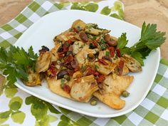 Pan Fried Whitefish with Artichokes, Olives, and Sun-Dried Tomatoes. See recipe at: http://www.seriouseats.com/recipes/2013/06/italian-easy-whitefish-artichokes-olives-sun-dried-tomatoes-recipe.html