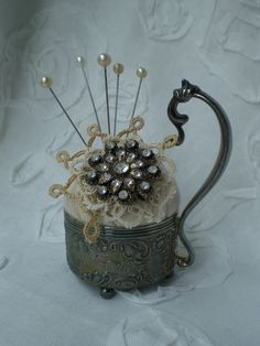 """Elegant and sophisticated pincushion in an old teacup or small bowl...could even go """"cute"""" with a fun coffee mug or children's cup."""