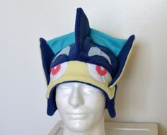 This is a stretchy fleece Greninja hat, made to order. Please let me know if you have any special requests (different colors, particularly small/large, no face, etc.). Hats typically ship within one week, but can take up to two during busy times of the year. If you need it sooner than that, let me know asap, and Ill let you know if its possible. All fabric is sewn, so there is absolutely nothing glued on. I also do custom hats if you have something in particular youre looking for. By re...