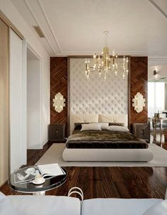 This bed room is nice because the bedspace is elegant and the chandelier adds an elegant effect whereas if it was just a ceiling light