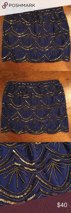 Hazel miniskirt This is such a beautiful skirt. I absolutely love the colors. Beaded and sequined with copper tone details on a cobalt blue skirt. So gorgeous. Size small. Originally purchased from South Moon Under. Hazel Skirts Mini