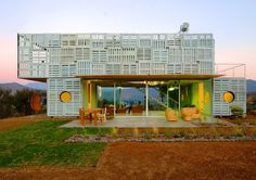 A green home built of 3 shipping containers, recycled pallets railway tracks and even plastic bottles. Located in Chile.  More on it at gizmag
