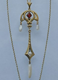 This is not contemporary - image from a gallery of vintage and/or antique objects. Art Nouveau Gold, Garnet And Pearl -Pendant - German c.1900