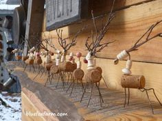 The tiny cork and twig reindeer displayed on the Livery woodshed...Rustic Christmas Ornaments | Primitive Twig Crafts