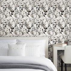 A botanical wallpaper for modern times. This watercolor design has an ink effect with bold shapes and subtle shifts in tone. From the darkest black to a pale grey, this neutral design is perfect redecorating.Call toll free 877-316-9930 for immediate help.