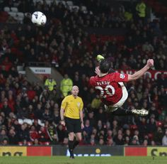 @manutd striker Robin van Persie fires an acrobatic effort on goal against Reading in the 2012/13 campaign. The Dutchman scored 30 goals for the club that season.