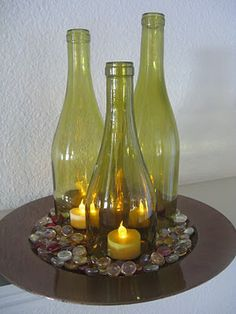 Grouping of wine bottles on charger plate with rock or glass accents