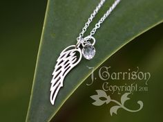 Guardian Angel wing jewelry <3 with ruby