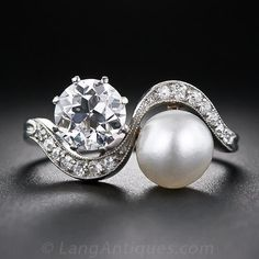 A sparkling, ice-white European-cut diamond, weighing carats and a lustrous white natural pearl snuggle up together in this exquisitely beautiful Edwardian twin stone ring, delicately crafted in platinum - circa 1915 Engagement Ring Buying Guide, Perfect Engagement Ring, Antique Engagement Rings, Diamond Engagement Rings, Vintage Rings, Vintage Jewelry, Vintage Diamond, Mothers Day Rings, Edwardian Jewelry
