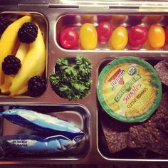 Planetbox. Baby girl's lunch today: organic hummus + organic flax seed corn chips Raspberries, grape tomatoes and parsley from the farmer's market Sliced mango Organic blueberry yogurt tube