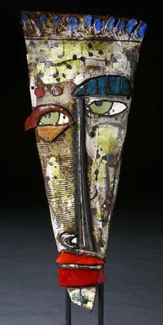 Kimmy Cantrall -links to a blog where grade 4 students did ceramic masks and used oil pasted and black paint for the embellishments.