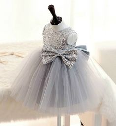 Silver Sequin Girl Dress-Made To Order Sparkle Silver Sequin Little Girl Party Dress Available from 2 - 14 years Material: Soft tulle mesh, cotton, seqquin fabric and satin Before checkout, you may leave a note your little girl's height, bust and waist measurements so we can process it and send you the right size. #silverdress #graytutudress #Littlegirlpartydress #flowergirldress