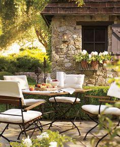 BohThe abundant sun–dappled foliage surrounding this alfresco dining room creates a charming sense of enclosure even while sharing a meal under an open sky.