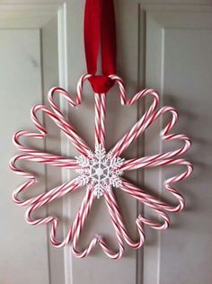 Candy cane wreath Saw this and thought it was adorable  inexpensive to make!