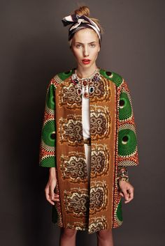 Stella Jean is an Italian based designer of mixed Haitian and Italian lineage.she designs amazing clothes using traditional African fabrics and takes them somewhere different all together.love this fabulous coat with oversized print: African Inspired Fashion, African Print Fashion, Africa Fashion, Ethnic Fashion, Fashion Prints, Fashion Design, African Prints, African Print Clothing, Fashion Styles