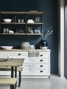 Neptune walls painted in Teal emulsion, Carter shelves, Longton large pot, Henley kitchen in Snow from £14,000
