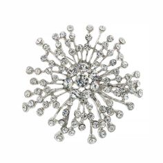 "Crystal spray brooch - a flashy, affordable accent.  2 1/4"" across."