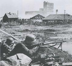 Grain elevator building and silos, as yet undamaged. September 1942.
