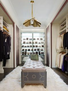 An arresting vintage pendant by Tommasso Barbi is suspended over a custom bench in Florence's walk-in closet | archdigest.com