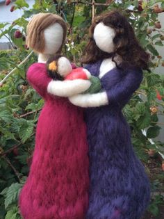 Needle felted mothers with their baby