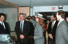 Sean O'Dwyer has a fake bottle smashed on his head by Sarah Ferguson, Duchess of York watched by Prince Andrew (right) during a visit to Movie studios, Los Angeles, United States of America March 1988