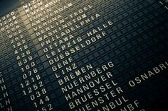 """Old-style """"flippy"""" departure board at Frankfurt Airport in Germany"""