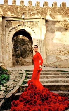 high fashion photo  ... Spain ... castle ruins ... red evening gown with flamencop/sevilla look ...