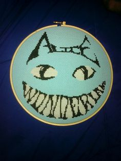 Glow-in-the-dark Cheshire Cat cross stitch | Flickr - Photo Sharing! ---- wow definitely one of my favorite Alice in Wonderland pieces I've seen