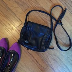Black Leather Crossbody Super cute Crossbody leather purse with built in credit card and license holder. Many compartments and perfect for a night out. Very good condition  Brand is: SPT not fossil Fossil Bags Crossbody Bags
