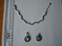 Bracelet and earring set made from white metal and set with white stones. Ref:  45140023368-MJS/35