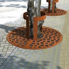 corten tree guard on square tree grid with casual dots pattern
