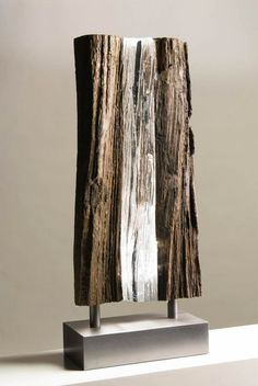 The sculptures by Dutch artist Diederik Storms, based in Bellingwolde, who mixes with subtlety petrified wood, stone and plexiglass to provide transparency