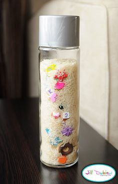 """I Spy"" bottle:  made this one for a 4-year-old cousin.  Empty the water bottle the day ahead and so it can dry COMPLETELY.  Instead of rice for filler, get a bag of bean-bag filler at the craft store (the beads are round and clear, not rice-y). DO NOT forget to take a pic of the contents, so you have an ""answer key"" for the hunt!"